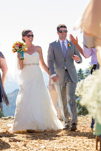bride and groom in shades